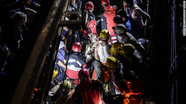 An injured miner is carried out by rescue workers. The mine shaft is about two-thirds of a mile -- or 1 kilometer -- underground, a disaster agency said.