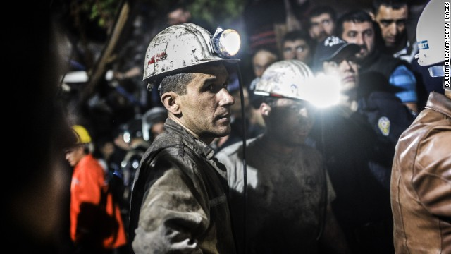 Miners stand by after the explosion. About 100 rescuers, dozens of ambulances and helicopters were dispatched to the scene.