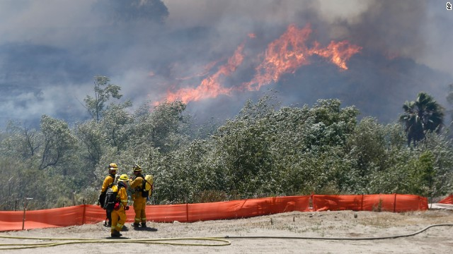 Firefighters prepare to take on a wildfire in San Diego.