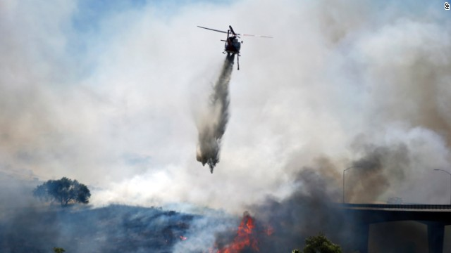 A helicopter battles a San Diego wildfire on May 13.