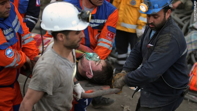 Rescue workers carry a survivor from the mine on May 14.
