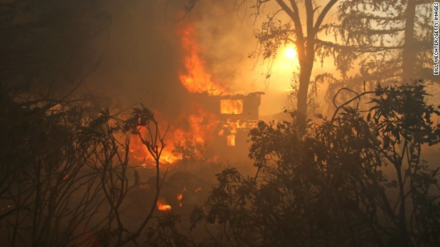 A house in San Marcos is consumed by a wildfire on May 14.