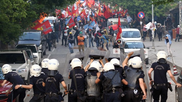 Protesters clash with riot police in Ankara on May 14.