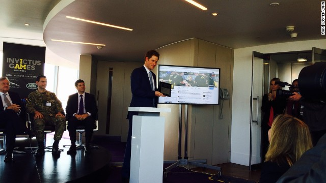 Prince Harry sent his first tweet from the top of the British Telecom Tower in London Thursday.