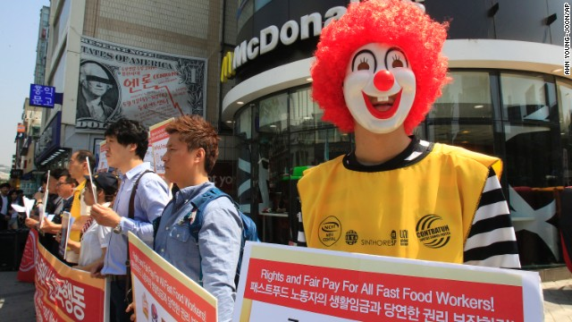 A protester dressed as Ronald McDonald participates in a strike outside a McDonald's in Seoul, South Korea.