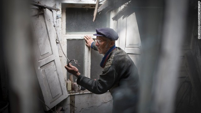 A man surveys the damage to his home after a mine exploded during an exchange of fire between pro-Russian militants and government troops outside Slovyansk on May 15.