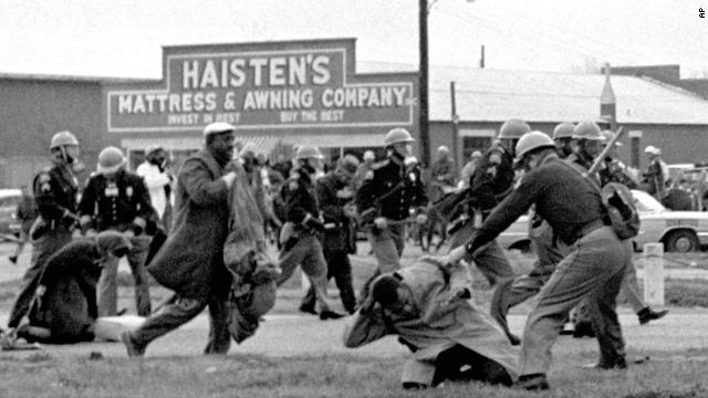 "State troopers swing batons to break up a civil rights voting march in Selma, Alabama, on March 7, 1965. <a href='http://www.cnn.com/2010/US/03/07/selma.march.anniversary/'>""Bloody Sunday,"" as it became known</a>, helped fuel the drive for passage of the Voting Rights Act of 1965."