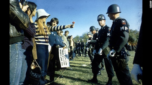 A demonstrator offers a flower to military police at the Pentagon during an anti-Vietnam protest in Washington on October 21, 1967. Marches such as this one helped turn public opinion against the war.