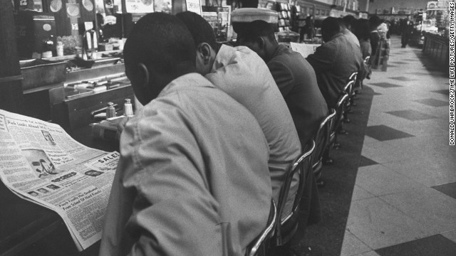 "On February 1, 1960, four African-American college students made history just by sitting down at a whites-only lunch counter at a Woolworth's in Greensboro, North Carolina. Service never came for <a href='http://www.cnn.com/2011/US/06/07/greensboro.race/'>the ""Greensboro Four,""</a> as they came to be known, and their peaceful demonstration drew national attention and sparked more ""sit-ins"" in Southern cities."