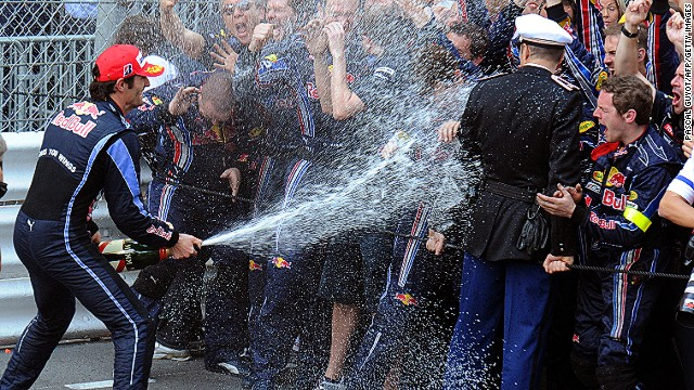 """Generally we try to spray the police but they're a bit serious,"" says Webber, shown here taking aim during one of his champagne moments in Monaco."