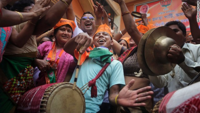 Supporters celebrate the opposition's victory in early preliminary results in Guwahati on May 16.