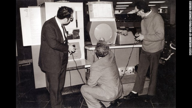 "In 1962, Massachusetts Institute of Technology students Steve Russell, Martin ""Shag"" Graetz and Alan Kotok created ""Spacewar!"" which is widely considered the first interactive video game. Dueling players fired at each other's spaceships using early versions of joysticks. This photo shows the three ""Spacewar!"" inventors playing the game at Boston's Computer Museum in 1983."