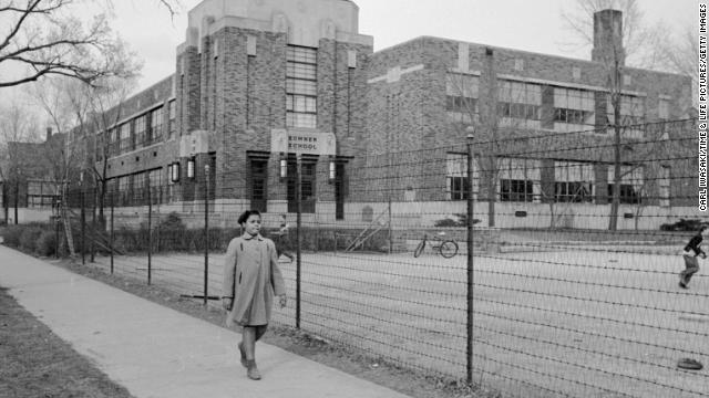 Linda Brown, 9, walks past Sumner Elementary School in Topeka, Kansas, in 1953. Her enrollment in the all-white school was blocked, leading her family to bring a lawsuit against the Topeka Board of Education. Four similar cases were combined with the Brown complaint and presented to the U.S. Supreme Court as Brown v. Board of Education. The court's landmark ruling on the case on May 17, 1954, led to the desegregation of the U.S. education system.