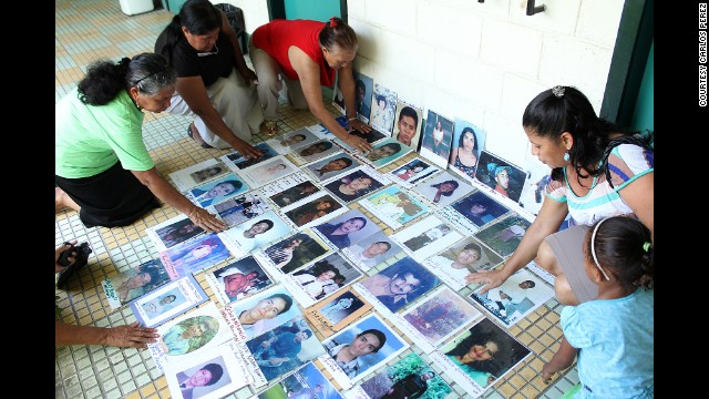 Volunteers in Honduras show photos of some of the missing migrants they are searching for. In the city of El Progreso, at least 350 people have gone missing on the dangerous trek north from the Central American nation to the United States.