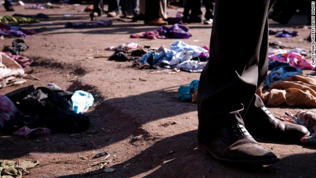 Clothes lie scattered on the ground after twin explosions in central Nairobi on Friday, May 16. Two suspects were arrested in connection with the blasts, which were caused by grenades, police said.