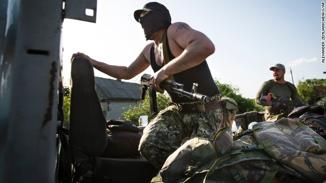 Pro-Russian gunmen take up positions to fight Ukrainian national troops at a checkpoint outside Slovyansk on Thursday, May 15.