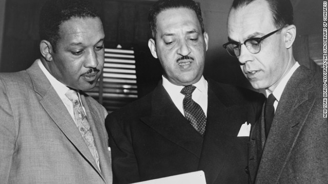 From left, lead lawyers Harold P. Boulware, Thurgood Marshall and Spottswood W. Robinson III confer at the U.S. Supreme Court prior to presenting arguments in 1953. Marshall, the NAACP's Special Counsel and lead counsel for the plaintiffs, argued the case before the Supreme Court.