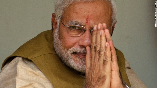 Narendra Modi gestures to supporters after seeking his mother's blessing in Ahmedabad, India on May 16, 2014.