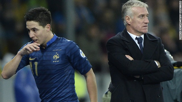 Samir Nasri (left) was omitted from France's World Cup squad by national coach Didier Deschamps (right).