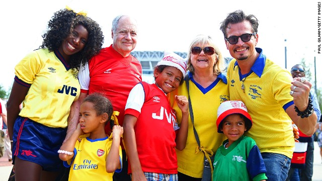 Arsenal fans pose outside Wembley Stadium before kick-off.