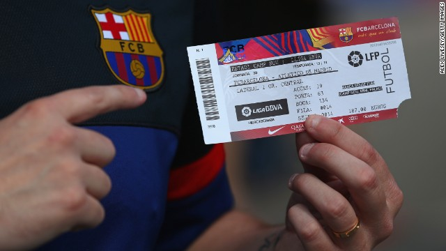 Both Barcelona and Atletico knew that victory would earn them the championship. Here a fan shows off a ticket for the title decider at Barca's Nou Camp.