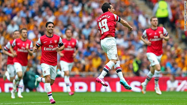 Santi Cazorla celebrates after scoring a brilliant freekick in the first half.
