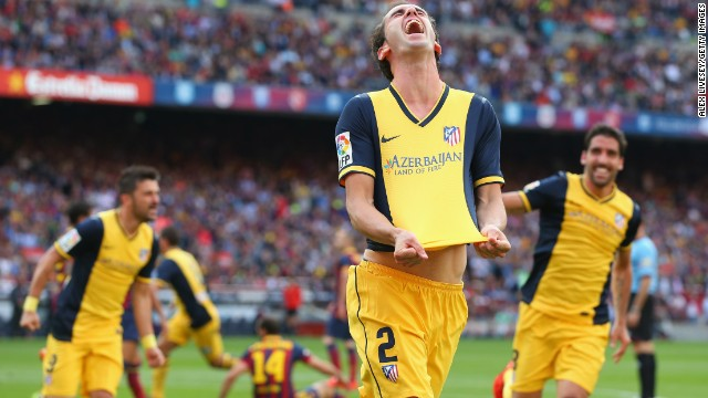 But Diego Godin scored a second-half equalizer, which was enough to seal Atletico's 10th title overall -- 12 behind Barca and 22 adrift of the record held by city rival Real Madrid.