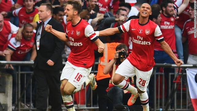 Aaron Ramsey (left) celebrates after scoring the winning goal for Arsenal against Hull City in the FA Cup final on Saturday.