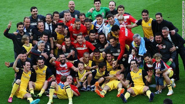 Atletico's players, staff and family members pose for the cameras following a dramatic denouement to the La Liga season.