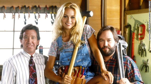 "Tim Allen, Anderson and Richard Karn in ""Home Improvement,"" where Anderson played Tool Girl, Lisa."