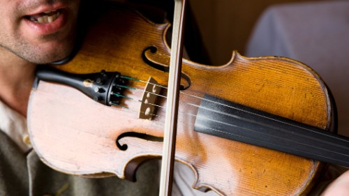 Traditional fiddle music in Cape Breton has deep Scottish roots.