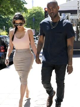 Before their May 24 wedding, lovebirds Kim Kardashian and Kanye West pretty much took over Paris. Here, the couple -- who often enjoy matching one another -- take a pre-wedding stroll in the City of Light on May 19. This moment's pretty kute, but how does it stack up against these other PDA-filled moments?