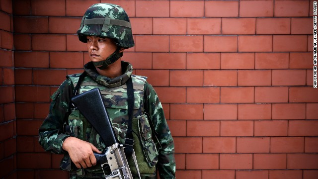 A soldier stands outside the Government Public Relations Department building on May 20.