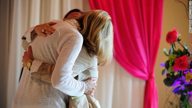 Julie Engbloom, left, and Laurie Brown embrace after they were wed in Portland, Oregon, on Monday, May 19. A federal judge struck down the state's voter-approved ban on same-sex marriage.