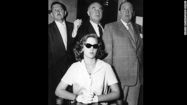In 1958, a then 14-year-old Cheryl Crane, daughter of actress Lana Turner, stabbed her mother's boyfriend, Johnny Stompanato. Crane told police Stompanato, who had ties to organized crime, had threatened her mother with a knife. Here Crane is shown with three unidentified men at the time of her trial, which resulted in a ruling of justifiable homicide.