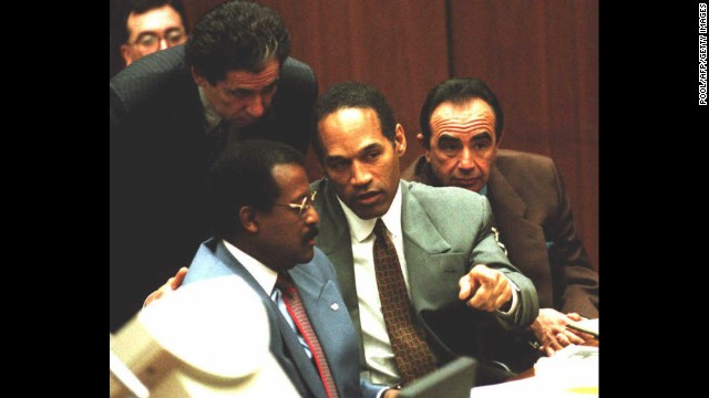 Probably one of the most famous cases ever involving a celebrity, O.J. Simpson, center, was arrested for the murders of his ex-wife, Nicole Brown Simpson, and her friend, Ron Goldman, in 1994. Here he confers with attorneys Johnnie Cochran, left, and Robert Shapiro, right, during a hearing in 1995. Simpson's friend Robert Kardashian stands behind him. Simpson, a former professional football player, was acquitted in the criminal case.