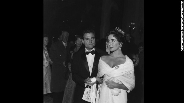 Elizabeth Taylor swaddles herself in white for the 1957 festival, accessorizing with a modest crown and her third husband, producer Mike Todd.