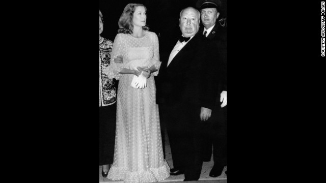 "Grace Kelly poses with director Alfred Hitchcock during the 1972 Cannes Film Festival. The pair worked together on three films, ""Dial M for Murder"" (1954), ""Rear window"" (1954) and ""To Catch a Thief"" (1955) before she gave up her acting career at 25 to focus on her duties as Princess of Monaco."