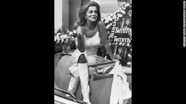 "Swedish-American actress Ann Margret rides around the streets of Cannes in all white during a photo call in 1975. Margret used her backcombed hair and white leather boots to promote British film director Ken Russell's musical film ""Tommy"" in which she played Nora Walker."