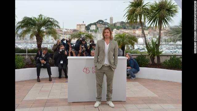 "It is not immediately clear why this long blonde hair and white lace up look works, but it really, really does. Brad Pitt works the photo call for ""Killing Me Softly"" in Cannes, 2012."