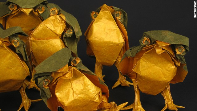 Origami artist Bernie Peyton created each of these baby owls using just one sheet of paper, which was gold on one side and green on the other.