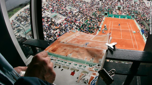 Blanc is not alone in painting the French Open. Franck Lehodey here recreates Monfils' clash with Dick Norman in 2006.