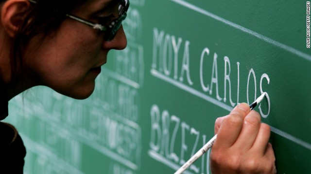 Artwork can be seen all around the Stade Roland Garros complex. Here a woman paints stadium signage on day five of the 2007 French Open.