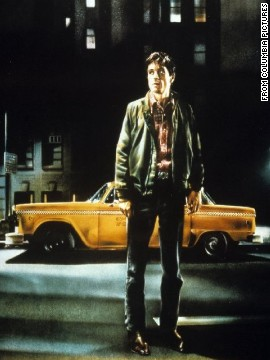 A 23-year-old Robert De Niro as Travis Bickle. The film follows ex-marine Travis as he becomes a taxi driver to cope with chronic insomnia, driving passengers every night around the boroughs of New York City.
