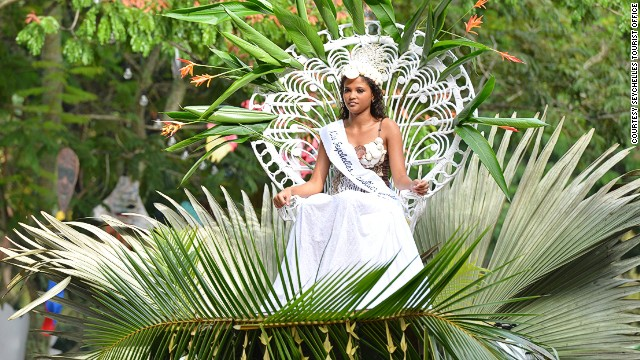 Miss Seychelles leads the procession.