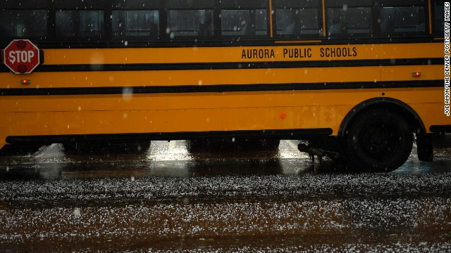 Empty buses wait for students during a tornado warning at Kenton Elementary School in Aurora on May 21.