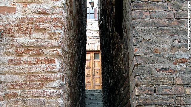 It's a claim that's hotly contested by rivals including the town of Ripatransone, which draws crowds of visitors to see its tiny passageway.