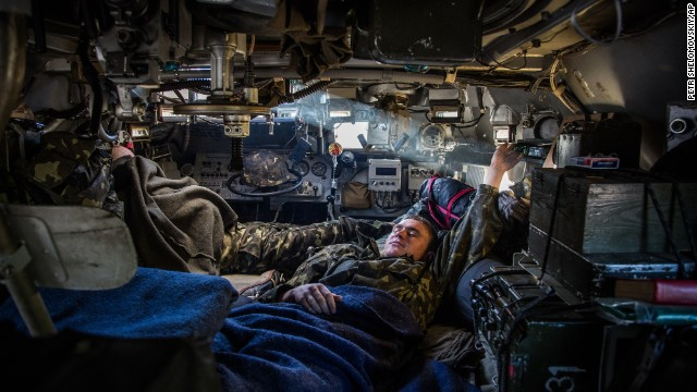 A Ukrainian soldier rests inside an armored personnel carrier at a checkpoint near Slovyansk on Wednesday, May 21.