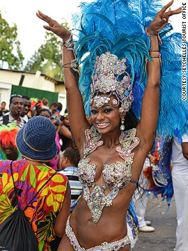 Of course, it wouldn't be carnival without a few scantily-clad to join the procession.