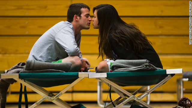 Nathan Westerfield kisses his wife, Mickella, at the Red Cross shelter set up at Sinagua Middle School in Flagstaff on Tuesday, May 20. The couple from Phoenix got married days earlier and were celebrating their honeymoon by camping out in Oak Creek Canyon.